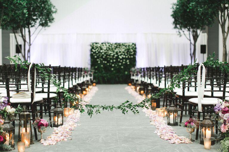 Lit Lanterns and Rose Petals ceremony aisle decor