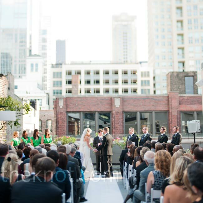 "The couple exchanged vows on the restaurant's rooftop, keeping the décor simple. ""The skyline was all that was needed,"" Jennifer says."