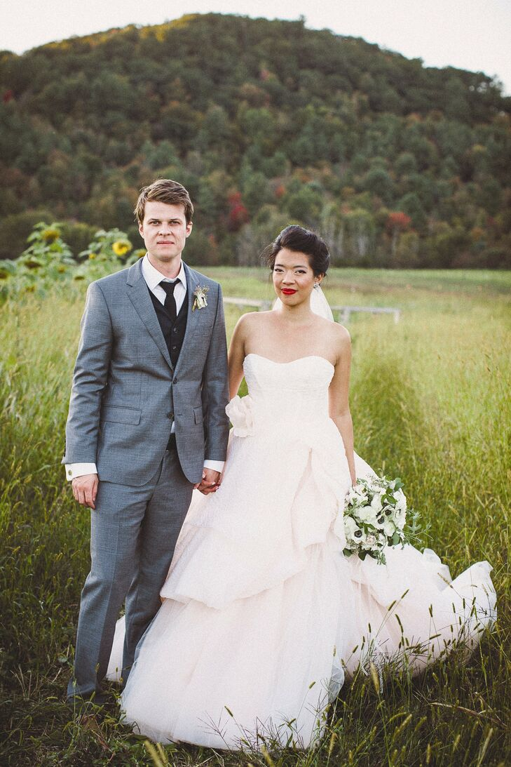 Olivia and Lucas maintained a barn aesthetic by using light shades of peach, orange and pink to soften their rustic venue.