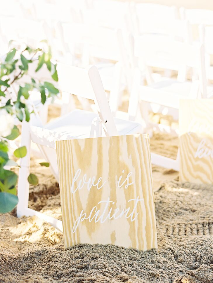 Taylor and Caleb wanted their ceremony to be very simple with minimal decor, to keep their focus on coming together as one before God. The aisle was lined with untouched wood that Taylor calligraphed with lines from Corinthians 1:13.