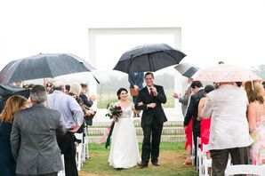 Bride and Groom Recessing from Ceremony with Umbrellas