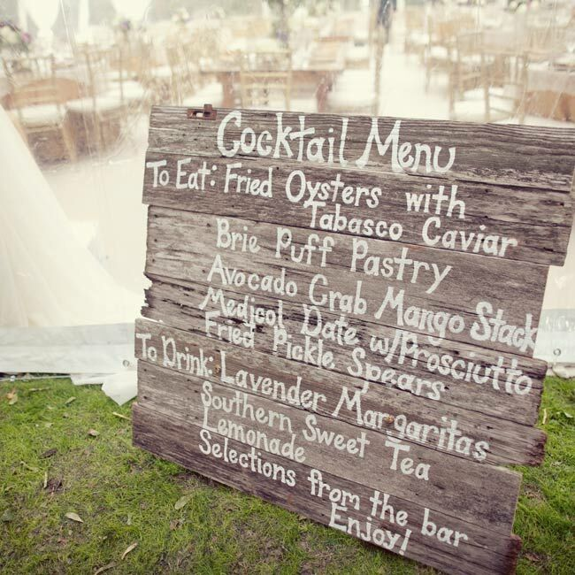 A weathered wooden sign listed the refreshments served at the cocktail hour.