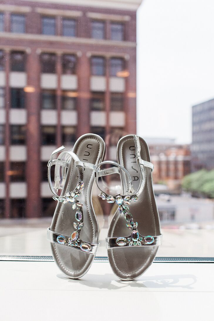 Amber's sparkly silver shoes added a dazzling touch to the couple's modern, clean wedding.
