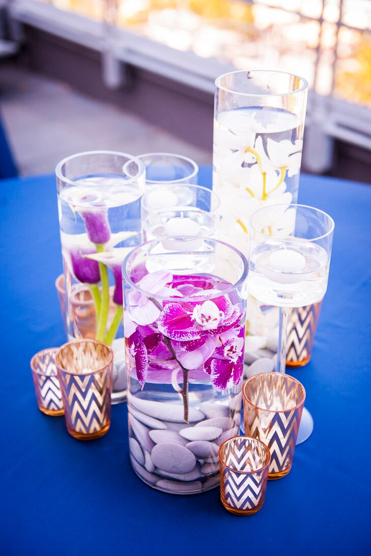 "On dining tables, circular glass vases were filled with water and purple or white orchids. The centerpieces were surrounded by gold candles. ""Our color palette consisted of dark blue, gold and lilac, offset by white flowers,"" says Alastair. ""We were interested in making a strong association to the 'Gatsby' era while still respecting the modern setting of Hotel Vitale."""