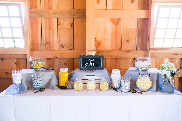 Lauren and Drake set up a sweet spread made up of candies in different colors. Guest received mason jars, which they filled with candy and took home.