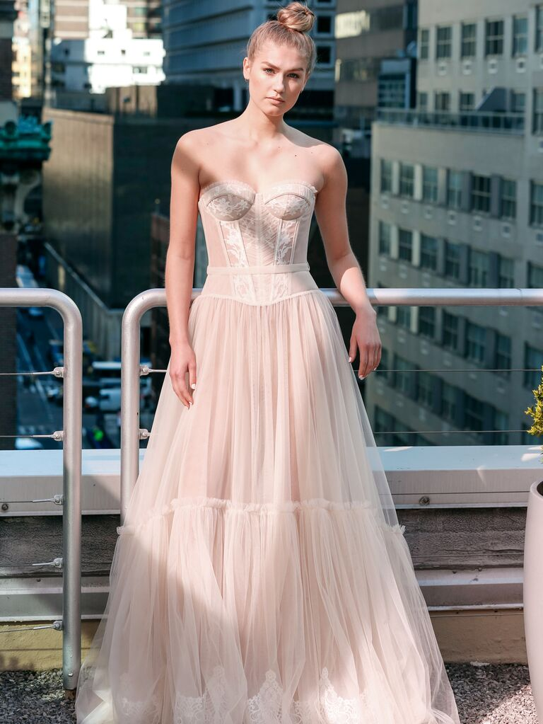 Eisen-Stein Spring 2020 Bridal Collection off-white wedding dress with bodice and tiered tulle skirt