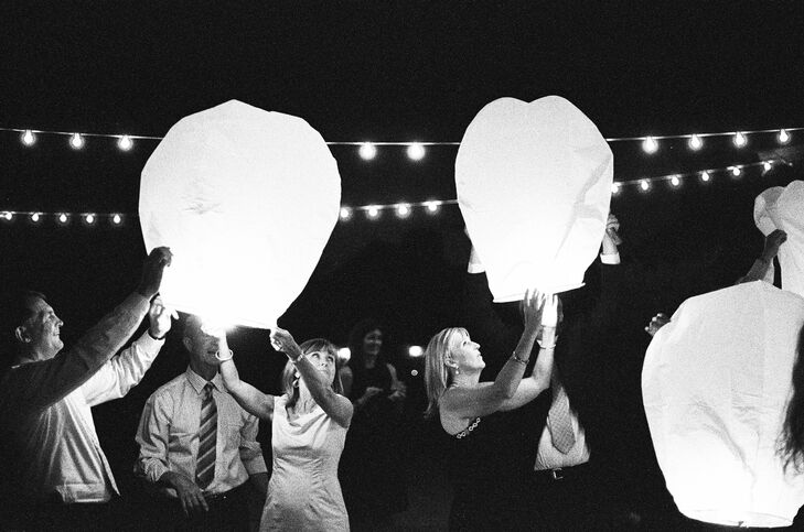 Before the reception started, the couple and their guests lit Chinese wish lanterns and watched as they floated into the night sky.