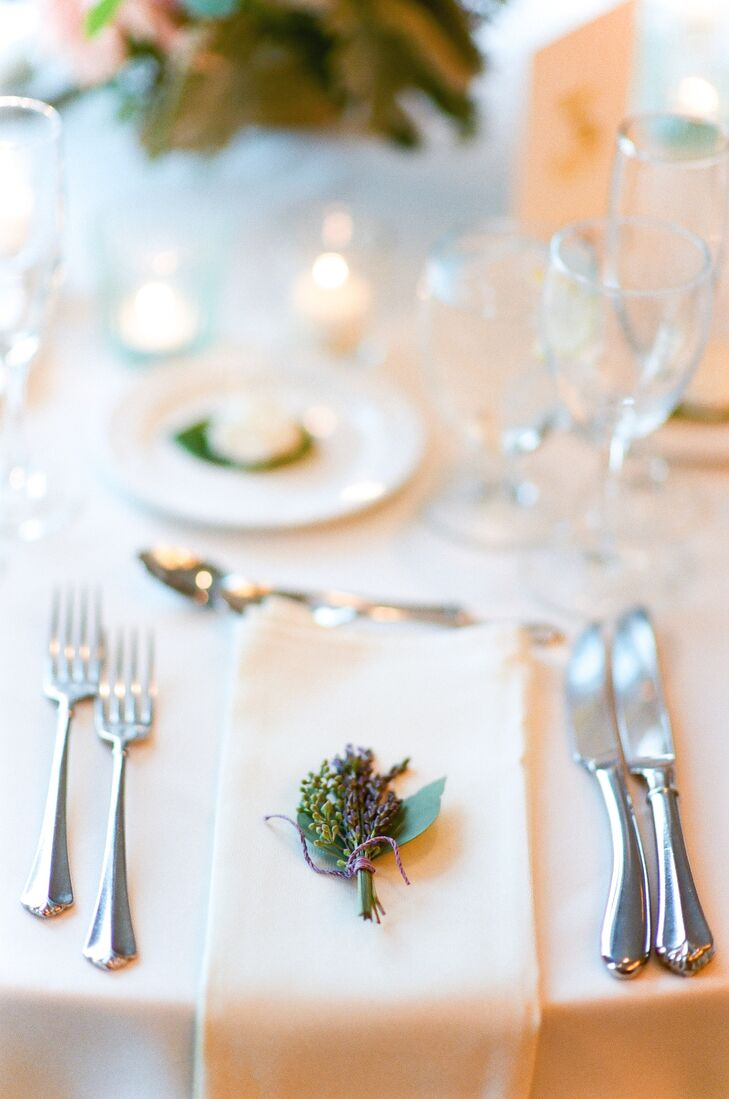 The decor struck the perfect balance of classic elegance and West Coast chic with warm golden accents, textured blooms and understated touches like bundles of fresh lavender at each place setting and wine-cork place card holders made by the couple.