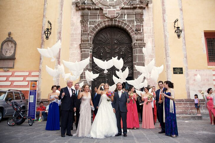 Instead of a classic confetti or rice toss at the end of the ceremony, the newlyweds' family members and friends released dove-shaped balloons into the bright sky.