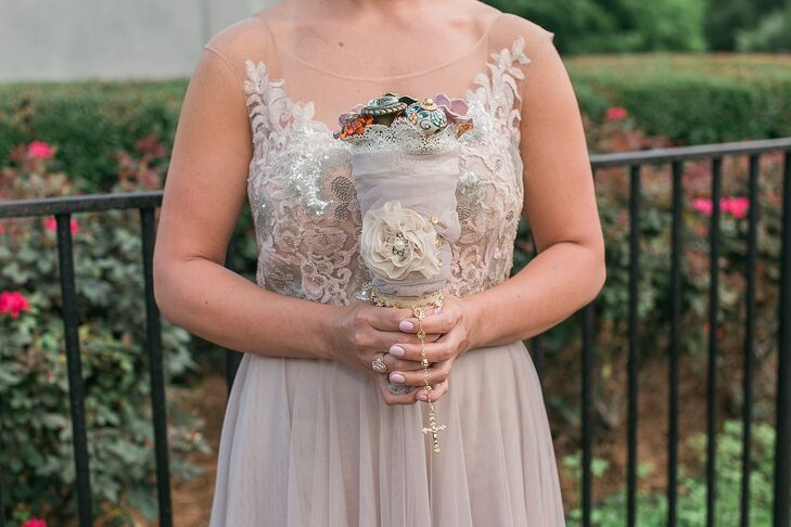 """On top of having an alternative, cabinet knob bouquet, Amber wanted her arrangement to be extra-personal.  """"My grandmother's rosary wrapped around the bottom of the bouquet,"""" Amber says. """"She passed away in 2003, so it was nice to have something of hers so close to me on that day."""""""