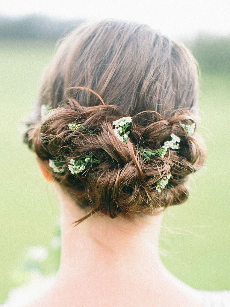 Low boho bridesmaid haistyle with fresh flowers