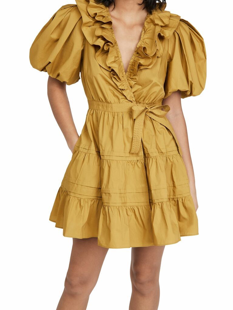 mustard mini dress with tiered skirt, puff sleeves and V-neckline