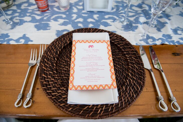 Rattan Charger Topped with an Orange Menu Card