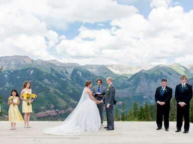 Scenic wedding ceremony next to a mountain range