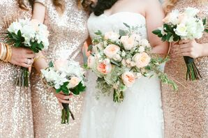 Pale Bridal Party Bouquets with Peach Accents