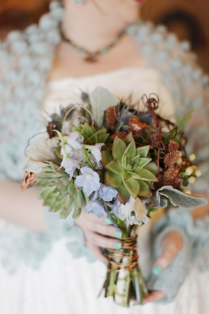 Sara had strong feelings about not wanting pink, red, carnations or roses in her bridal bouquet. She requested succulents, and her florist came up with the rest, sticking with a whimsical, woodsy, rustic theme in blues, greens and copper.