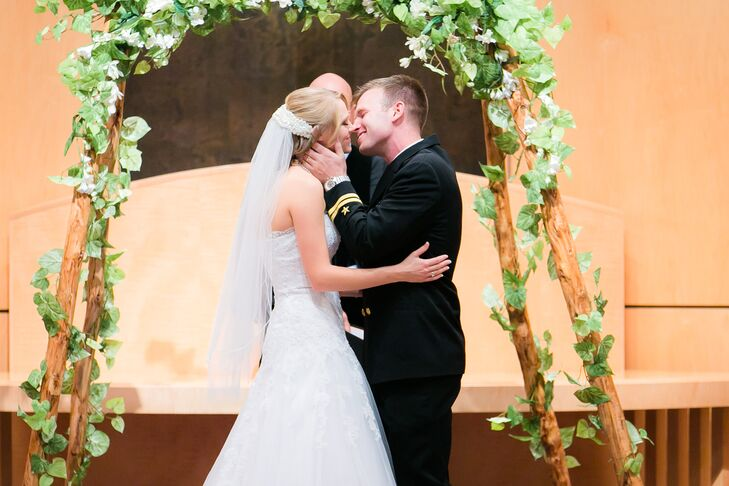 First Kiss at Wedding Arch