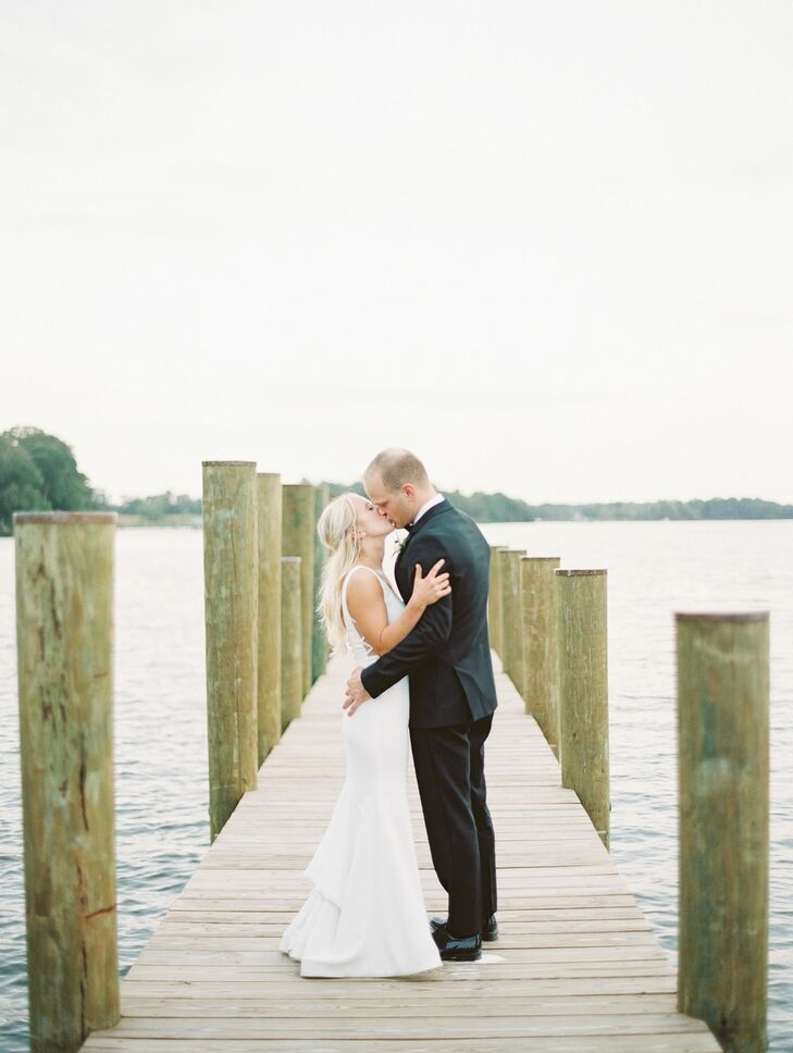 Bride and Groom Embrace on Pier at Wye River Estate Wedding