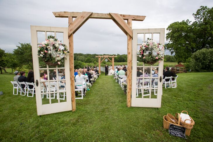 Haley's handyman father salvaged old doors from Washington, DC, and drove them to Festus, Missouri, for the wedding. He built a grand wooden frame to support them and white-washed each door for a grand, picturesque entrance for Haley.