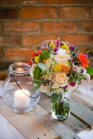 Colorful Craspedia and Blue Thistle Bouquet Centerpiece