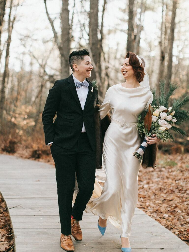 bride and bride in vintage-style attire and suit