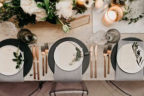 Dark Grey Chargers with Charcoal Linens, Gold Flatware and Herbs