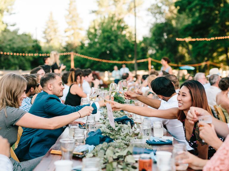 Guest toasting at wedding reception
