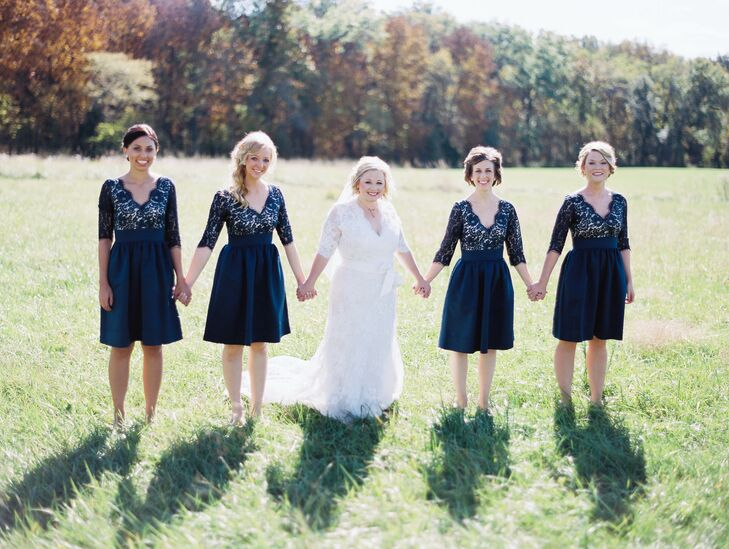 The bridesmaids wore navy dresses with lace tops, empire waists and A-line skirts from Nordstrom.