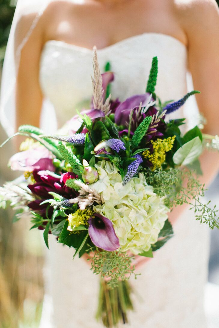 "Allison describes her bouquet of purple dahlias, green hydrangeas, green hypericum berries, lavender mini calla lilies, green millet, blue veronica, yellow solidago and seeded eucalyptus as ""wild enough for a garden, but elegant enough for a wedding."""