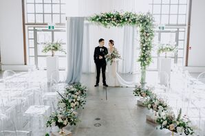 Romantic Fabric-and-Floral-Draped Wedding Arch