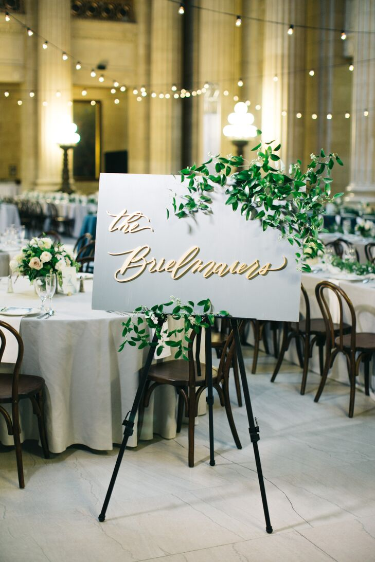 Laser Cut Calligraphy Sign with Greenery at Reception