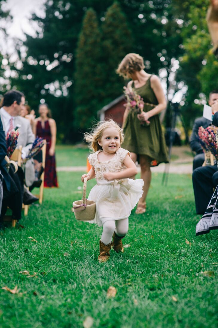 The flower girl wore a cream-colored dress as she sprinted down the aisle at the ceremony, with basket in hand.