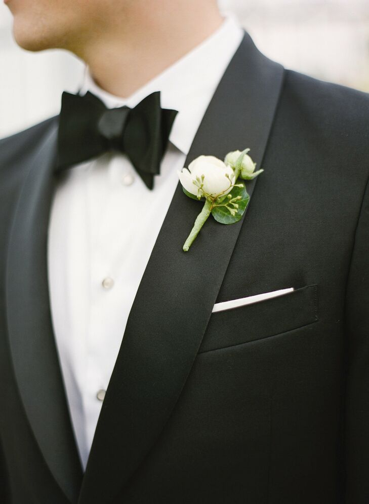A simple ivory peony boutonniere was placed on Ben's lapel.