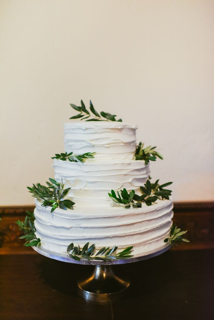White Buttercream Cake Topped With Olive Branches