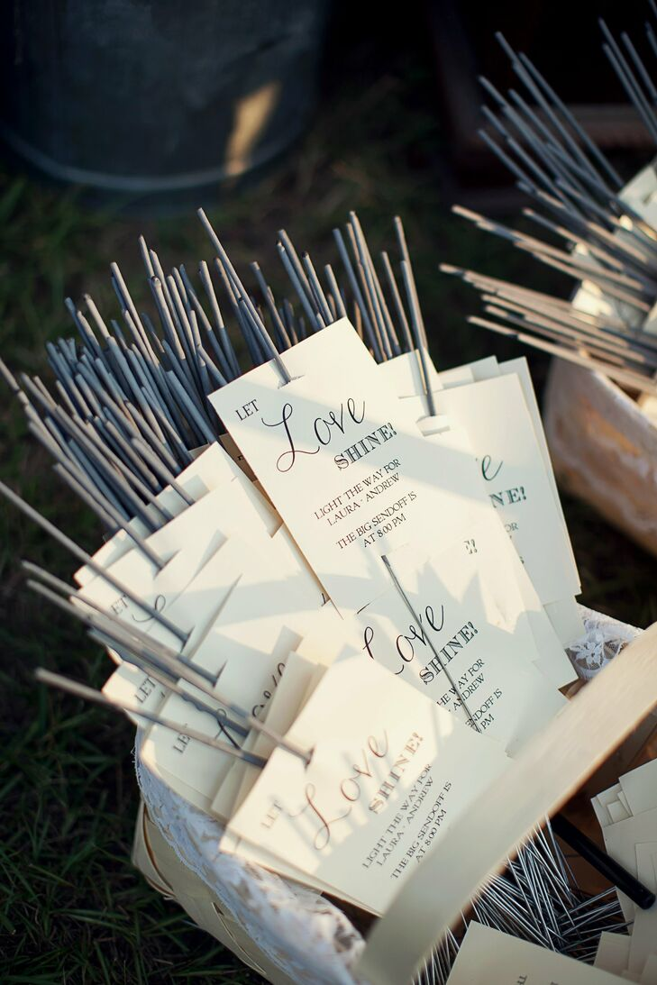 Picnic baskets were filled with sparklers for guests to use during the couple's exit following the reception.