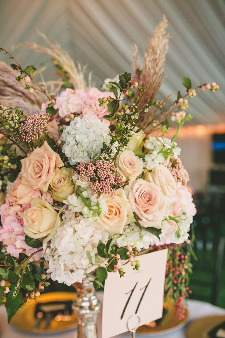 """We ordered special glassware that had a vintage and almost regal feel to really showcase the florals for my centerpieces,"" Elle says. ""Each piece was different, which made the atmosphere amazing."""