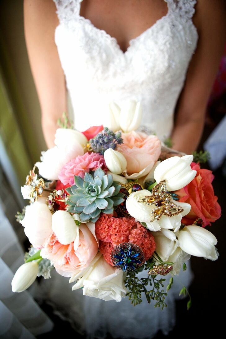 A mix of tulips (Katie's favorite flower), peonies, ranunculuses, garden roses, blue thistle, succulents and seeded eucalyptus made up the bridal bouquet.