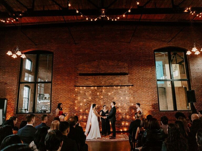 wedding officiant ceremony with twinkle lights