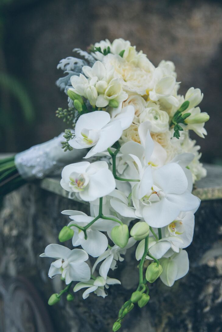 Cascading White Orchid Rose And Ranunculus Bouquet