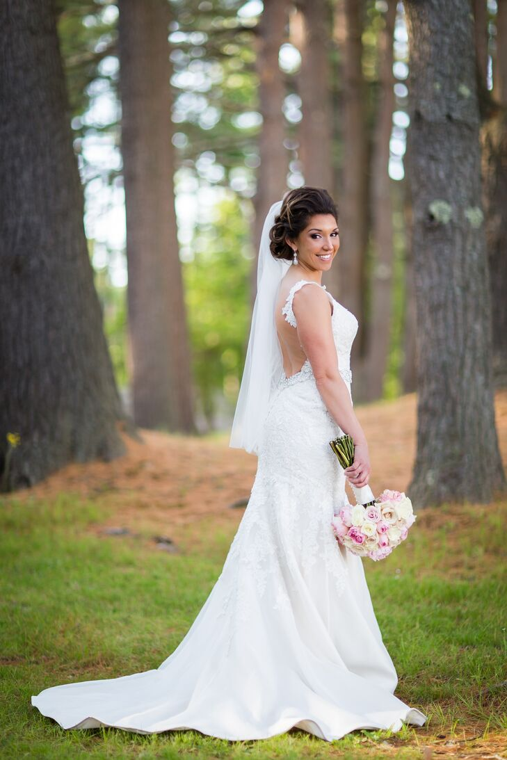 """On her first trip to Bella Sera Bridal, Justina wasn't quite sure what she was looking for in a gown. She tried on every style, from fit-and-flare to mermaid-style and even ball gown silhouettes. """"The dress I chose was actually one of the first dresses I tried on,"""" Justina says. """"I loved the drama and elegance that the dress had and I felt it complemented the venue, which was also dramatic and elegant."""" The Essence of Australia design had a mermaid-style silhouette, open back, subtle beaded embellishments and delicate lace straps."""