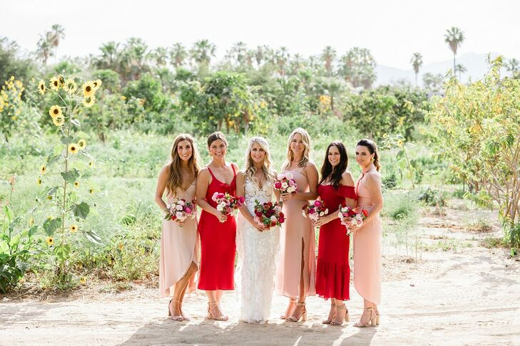 Bridesmaids with Red and Pink Tea-Length Dresses and Colorful Bouquets