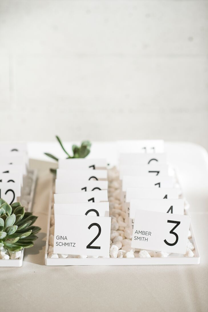 Minimalism was key for Marie and Chase's escort cards, which were made by Fuse Wedding and Events and featured a simple table number and the guest's name.