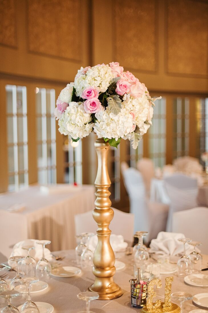 The tall gold centerpieces included white hydrangeas, blush roses and lamb's ear to complement the soft, romantic look of the day.