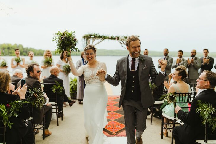 Elegantly Casual Couple Recessing from Waterfront Ceremony