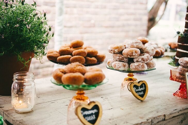 A whitewashed farm table featured a doughnut display (on vintage cake stands) and a naked vanilla cake made by Tonya.