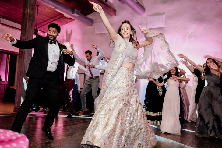 Couple Dancing at Reception with Lehenga and Suit