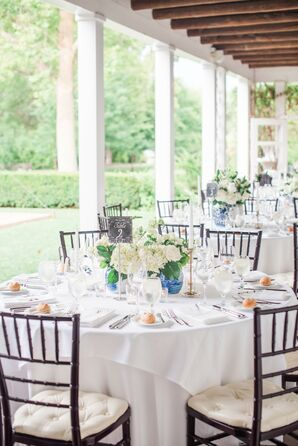 Round Table with White Linens, Chiavari Chairs and Elegant Centerpieces