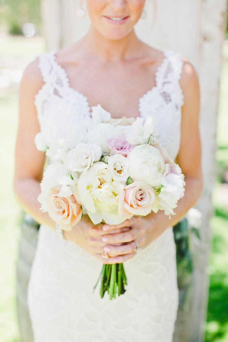 """Victoria held a romantic bouquet filled with pastel-colored roses and peonies, matching the day's soft palette. """"For me, flowers weren't something I had put a lot of thought into,"""" Victoria says. """"I knew I wanted to keep the bouquets simple, and thankfully, we have a family friend who put everything together perfectly."""""""