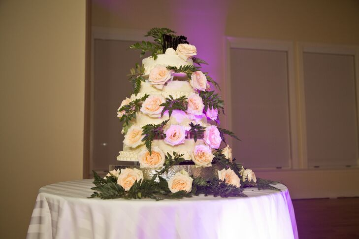 The white wedding cake was covered in blush roses and ferns. Jennie and Patrick chose a carrot cake for their wedding cake.