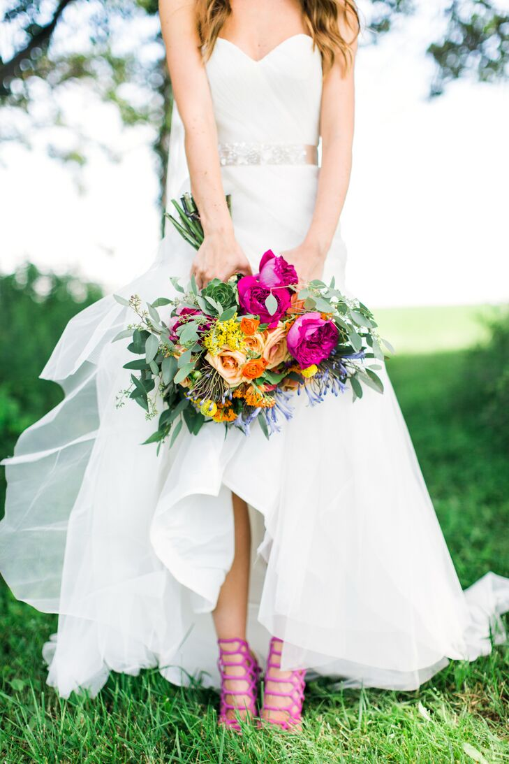 """I have a very modern style,"" Molly says of her punchy wedding day look. She accessorized her strapless, white sheath-style dress with a pair of hot pink Schutz heels for an added pop of color."